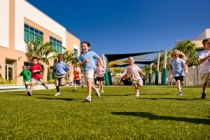 Photo of Children Running and Playing